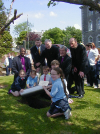 Archbishop Josiah, Mr Maguire (Belleek Pottery), Fr Lonergan, Bishop Jackson, and Rev Regan with Belleek school children