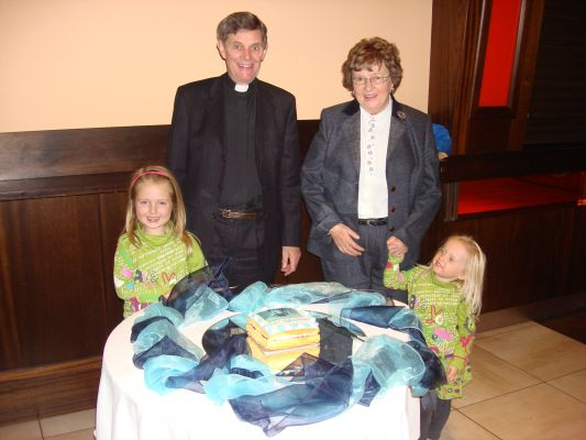 Canon Peter and Shelia Wilson with their grandchildren